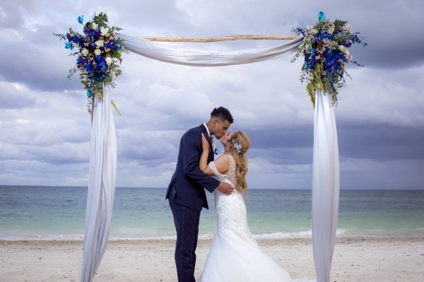 Gray and blue wedding arch